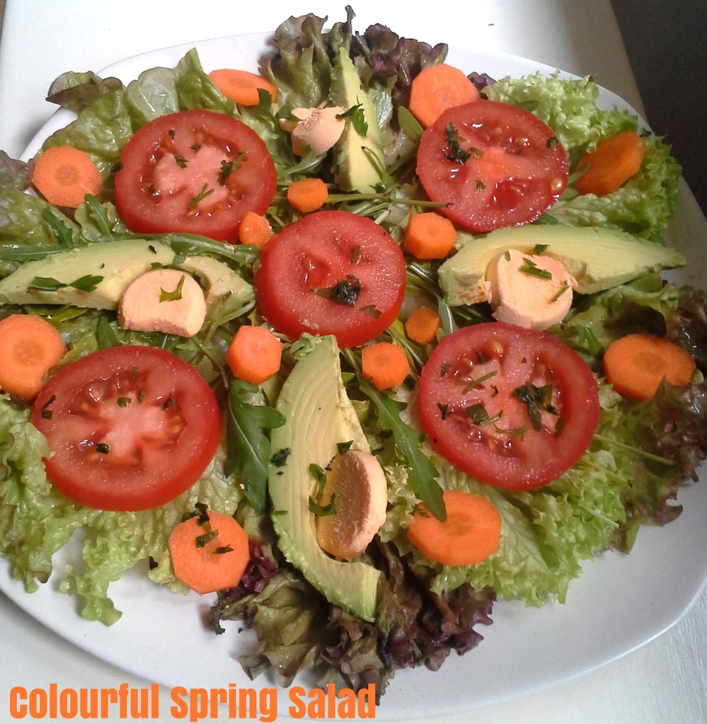 Colourful Spring Salad with avocado carrots and tomato